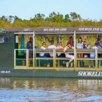 clients onboard shoreline hippo boat cruises